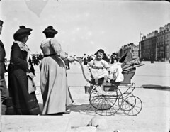 Tams and a Fez perambulating with a perambulator! (Rhyl in Wales) (National Library of Ireland on The Commons) Tags: clarkephotographiccollection jjclarke johnjosephclarke 1879–1961 brianpclarke–donor nationallibraryofireland perambulator walking tamoshanters headress ladies gentlemen children houses terrace promenade seaside pram fez tam tamcap seafront resort resorttown streetlights outforeign rhyl wales parade locationidentified eastparade westparade