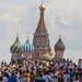 Tourists at Red Square with the Saint Basil's Cathedral in the background