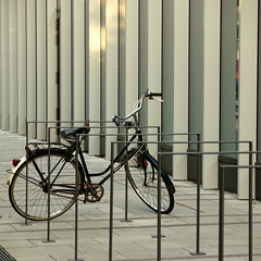 foreign matter (vertblu) Tags: bicycle bike officebuilding bicyclestand cyclestand cyclerack bikerack verticals horizontals pavement bsquare 500x500 vertblu innercity businessarea downtown concrete lines linien