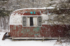 Old Trailer in Snowstorm in Central Michigan (Lee Rentz) Tags: april canadianlakes abandoned abandonment alone america antiquated camping centralmichigan curtains enchanted falling forest forsaken fun hermit home homey house lonely lonesome lowerpeninsula michigan nature northamerica old oldtimes paint precipitation recreation recreationalvehicle remote rustic rv season snow snowfall snowflakes snowing snowy stanwood trailer travel traveltrailer usa venerable weathered window winter woods
