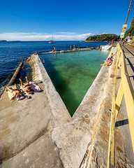 Sunbathers (Michael Rawle) Tags: sun pool beach ocean sunbathing path water things sunlight boat walkway manly places fence newsouthwales australia au