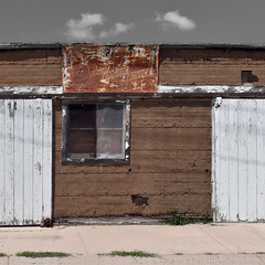 was, anyway (Patinagal) Tags: rust relic decay sign signage winow door garage facade