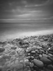 Pebble Wash II (Peter Henry Photography) Tags: sea beach coast pebbles tide waves stbees clouds longexposure wideangle seascape monochrome mono blackandwhite
