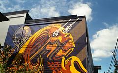 """Digital Renaissance"" (Yutaka Seki) Tags: mural festival wall art painted colourful vancouverbc ricohxr2s smcpentaxa35mmf20 fujicolorc200 homedeveloped unicolorpresskit futuristic digital renaissance willphillips sciencefiction scifi cybernetics robot android cyborg laser beams orange blueskies clouds"