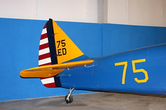 Painted Tail (Jay Costello) Tags: tusconaz tuscon pimaairandspacemuseum military airplane arizona blue yellow red striped