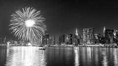 Illuminate (Elyssa Drivas) Tags: newyork newyorkcity nyc night nightphotography fireworks 4thofjuly july july4th independenceday eastside eastriver evening empirestatebuilding manhattan midtown downtown darksky blackandwhite illuminated fireworksshow