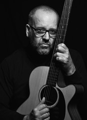 The Guitarist (cjpk1) Tags: musician guitar strings intense mono black white study portrait