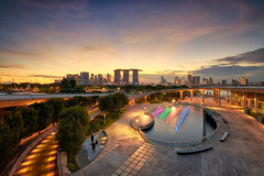 Marina Barrage Drama (Scintt) Tags: singapore marina bay exposure sunset light evening dramatic surreal travel urban exploration buildings cityscape city skyline architecture offices business tanjong pagar central district cbd financial jon chiang photography scintillation scintt sky clouds residential hotel integrated resort casino exclusive tourism shopping mall property dusk wide angle residences banks field glow orange fiery sun water starburst lens flare barrage rays twilight epic crepuscular long slow shutter haidafilter neutraldensity nanopro