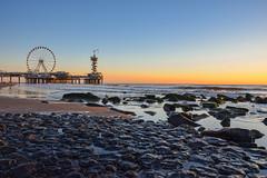 Sunset, ferris wheel and rocks (MicheleSana) Tags: pier netherlands sunset ferris wheel rocks sea ocean mare oceano tramonto ruota panoramica olanda aia den haag scheveningen spiaggia rocce