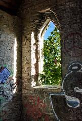 Where Art & Religion Meet (Katrina Wright) Tags: dsc1010 butterchurch cowichanbay abandoned derelict graffiti empty window light trees reflection shadow paint spraypaint
