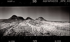 Peaks (tsiklonaut) Tags: horizon 202 panorama panoramic pano 135 35mm film analog analogue analogica analoog roll black white negro y blanco mustvalge qobustan azerbaijan mud volcano muda vulkaan dry dried cone volcanic landscape maastik aserbaidžaan azer bakuu baku wide travel discover experience drum scan drumscan scanner pmt photomultiplier tube people photo