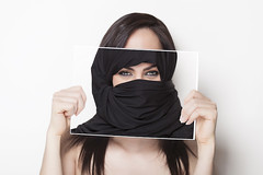 Girl holding a photo of herself wearing a burqa (goltunenews) Tags: girl brunette burqa arabic muslim mystery photograph nikab religion traditional veil message page billboard hidingbehind beautiful beauty woman card clipboard communicate communication concept contact design displaying female finger hair hand hold holding looking person portrait poster presentation presenting showing sign space white young horizontal isolated italy