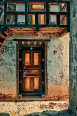 Bhutan: Inside Tengchu Goemba. (icarium.imagery) Tags: bhutan drukyul himalayas architecture artwork buddhist captureone goemba mahayanabuddhism monastery paro tengchugoemba door sonydscrx1rm2 travel vibrant colors cinematic