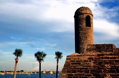 Harbor View (PelicanPete) Tags: fort fortress 7418 castillodesanmarcos coquinastone durable built16721695 usa whiteplaster towers fourcorners plasteredred saintaugustineflorida locallyquarriedsoftshellrock citygate wallaroundcity defense canons greengrass moat northwall necorner unitedstates history oldestmasonryfort building sky grass thenortheastbastion sunlitwalls shadedwalls wallcrack pathways bluesky clouds hot pilgrimage 5yrs july4th holiday architecture tower