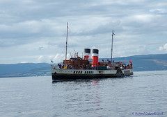 PS Waverley approaching Largs Harbour (Rourkeor) Tags: 1946 firthofclyde largs mzuikodigitaled12‑100mm140ispro omdem1markii olympus pswaverley paddlesteamer saltireflag scotland unitedkingdom gb ayrshire boats reflections clouds funnels