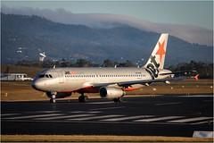 Jetstar.com (Trains In Tasmania) Tags: australia tasmania hobart hobartairport plane jetstar a320 airbusa320 hills runway aircraft canoneos750d