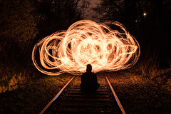 railway to the fire (Rudy Pilarski) Tags: nikon tamron d7100 2470 feu fire nuit night ray railway paris perspective personne people cercle europe europa arbre tree herbe pc light lumière lightpainting challengeclub