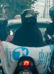 The pigeon (A. Yousuf Kurniawan) Tags: blue red motobike job work streetphotography urbanlife traffic woman colourstreetphotography decisivemoment muslim