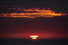 Inverted Sun (ianrwmccracken) Tags: horizon glow d750 nikon sunset sigma cloud whitby england telephoto atmosphere sea orange red