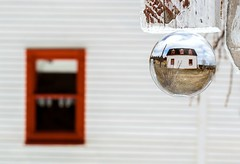 Cottage (Karen_Chappell) Tags: glass bubble ball orb sphere round circle white red refraction nfld newfoundland torscove cribbies avalonpeninsula atlanticcanada canada eastcoast house cabin window
