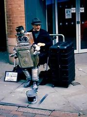 'Tappy the Robot'... (Esmik D'Aguiar) Tags: street portrait urban busker robot uk fuji ga645zi lomopeople red bricks nottingham glass reflection lomography