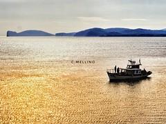 Qui dove il mare luccica... Here where the sea shines... (clausterrible) Tags: sonya5100 sonylenses sony alpha5100 alghero sardegna sardinia mediterraneo boat fisherman sea capocaccia
