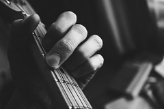A guitarist hand (freestocks.org) Tags: acoustic bw black blackandwhite chord chords closeup detail electric finger frets guitar guitarist hand hobby instrument les mahogany male maple music musical musician passion paul play practice practise rock standard string strings tab white wood wooden