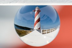 Red, White & Blue (Karen_Chappell) Tags: red white blue lighthouse nfld newfoundland heartscontent canada atlanticcanada avalonpeninsula eastcoast refraction glass orb sphere ball round circle