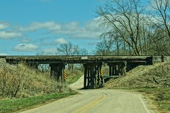 DOWNDA ONE LANE ROAD (chumlee10) Tags: bridge railroad under pass road wood blue sky clouds trees il illinois cherryvalley winnebagocounty wooden nostalgic rural