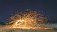 Steel wool fire twirling (Merrillie) Tags: catherinehillbay artisitic australia beach dark dramatic fire firespinning firetwirling light longexposure natural nature newsouthwales night nighttime nsw sparks steelwool steelwoolspinning
