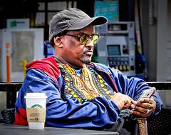 COFFE BREAK AT STARBUCK'$ (panache2620) Tags: coffee starbucks somali somalian portrait candid photojournalism eos minnesota canon minneapolis coffeebreak man male worker socialdocumentary