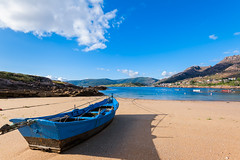 Fishing boat on the beach with blue sky background. (franco nadalin) Tags: background beach blue boat coast fishing holiday landscape marine nature nautical ocean outdoors paradise sand scene sea seascape ship shoreline sky tourism traditional travel vacation vessel view water