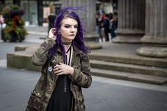 The Colour Purple (Leanne Boulton) Tags: people portrait urban street candid portraiture streetphotography candidstreetphotography candidportrait streetportrait streetlife young woman youth female girl face eyes expression mood feeling atmosphere goth gothic purple hair hairstyle makeup fashion style dark tone texture detail depthoffield bokeh alternative alt wind windy weather movement motion flowing naturallight outdoor light shade city scene human life living humanity society culture lifestyle canon canon5d 5dmkiii 70mm ef2470mmf28liiusm color colour glasgow scotland uk