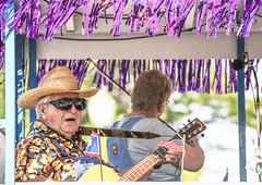 Pickin' (wyojones) Tags: wyoming parkcounty parkcountyfairparade powell parade float oldtimefiddlers guitarplayer man wyomingflag usflag wyojones