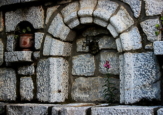 the stone fountain with the flower