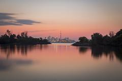 Morning Bliss (Nicoli OZ Mathews) Tags: sunrise toronto torontoskyline beautiful water reflection canada canon dawn colors shadow landscape lake light lakeontario longexposure cntower