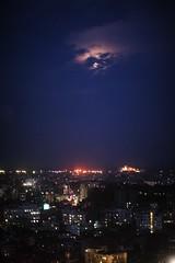 There Will Be Blood They Say (N A Y E E M) Tags: city sky moon night light availablelight lastnight bloodmoon terrace 20thfloor mezetto restaurant hotel radissonblu chittagong bangladesh vertical