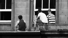 Improvised sun deck 02 (byronv2) Tags: peoplewatching candid street sunbathing seated sitting blackandwhite blackwhite bw monochrome lothianroad roof window men edinburgh edimbourg scotland