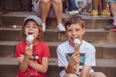 ellie and dan having ice cream (iamthecandleman) Tags: pple iphone 70 24 digital a7r sony bottle hat tshirt red depth background forground smile portrait look train niece girl people nephew ice cream