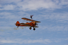 The Flying Circus Wingwalking Team, Shuttleworth Collection Family Air Show, Bedfordshire (IFM Photographic) Tags: img4008a breitlingstearman breitling stearman theflyingcircuswingwalker wingwalker wingwalking nikita aerosuperbatics canon 600d sigma70200mmf28exdgoshsm sigma70200mm sigma 70200mm f28 ex dg os hsm apo tele converter 2x af teleconverter oldwarden bedfordshire beds shuttleworthcollection shuttleworthhouse familyairshow airshow aircraft aeroplane plane airplane boeing