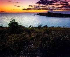 Lighthouse at dusk (GOJR.) Tags: vintage sunset slidefilm mamiyarb67pros mamiyasekorc50mmf45 velvia50 dusk caborojo puertorico mediumformat 6x7 e6 beach color analog film