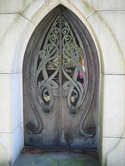Holme Mausoleum Art Nouveau Doorway 0924 (Brechtbug) Tags: mausoleum tomb with art nouveau doorway mausoleums grave markers head stones graveyard graves yard architecture sculpture statue women lady marker mourner mourning grief grieving lily flower flowers bronze ivy bronx stone resting tombstone woodlawn nyc new york city 2007 october 10122007