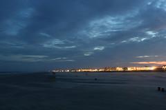 feel the breeze (Olli.Dr) Tags: ocean coast evening feel wind sand dark blue sky city lights canon summer night