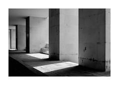 Cripps Building (realjv) Tags: architecture blackwhite blackandwhite cambridge columns crippsbuilding fuji fujifilm geometric lightbeam monochrome shadows stjohnscollege x100 x100t