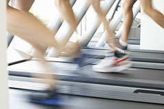 running on treadmill (mghresearchinstitute) Tags: gym gymequipment exerciseequipment running run runner runningmachine treadmill threepeople male female man feet closeup jog jogging jogger healthy keepfit keepingfit workingout exercise exercising men indoors training moving motion motionblur speed fast unrecognisableperson horizontal