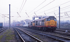 Two unidentified Class 31s are pressed into service on this Felixstowe-Coatbridge via March intermodal on 17January 1991. Ready for departure from Ipswich Yard (mikul44171) Tags: