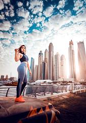 Sharon (Sajeesh KV) Tags: model dubai city skyline woman lady fitness clouds towers buildings sunrise fit