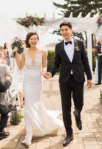 Kyle Ozawa and bride Rebecca walking down the aisle