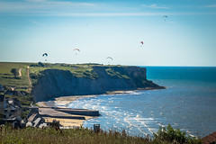 More parasailers having fun along the Normandy coast.