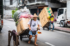 Two porters, old and young (Goran Bangkok) Tags: chinatown hat porters walking bangkok thailand asia street streetphotography men workers